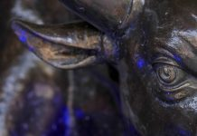 A bronze bull statue at the entrance to Bombay Stock Exchange | Dhiraj Singh/Bloomberg
