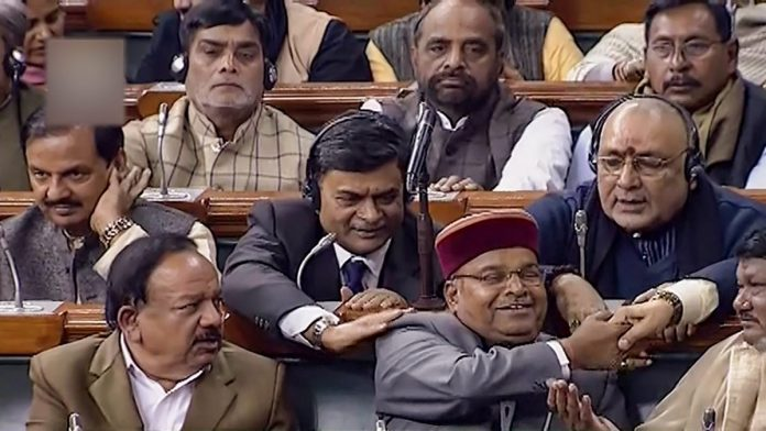 Social Justice minister Thawarchand Gehlot and other MPs after Lok Sabha passed the 10 per cent quota bill | PTI