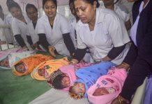 Nurses hold babies | PTI