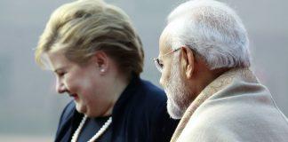 Prime Minister Narendra Modi in conversation Norwegian PM Erna Solberg during the ceremonial reception at Rashtrapati Bhavan in New Delhi | Praveen Jain/The Print