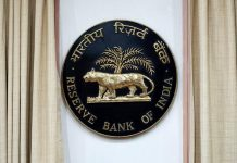 The Reserve Bank of India (RBI) logo is displayed inside the central bank building in Mumbai