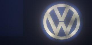 The Volkswagen AG logo | Krisztian Bocsi/Bloomberg