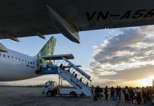 Passengers disembark a Bamboo Airways airplane at Phu Cat Airport in Qui Nhon, Vietnam