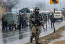 Awantipora: Army soldiers near the site of suicide bomb attack at Lathepora Awantipora in Pulwama district of south Kashmir, Thursday, February 14, 2019. At least 30 CRPF jawans were killed and dozens other injured when a CRPF convoy was attacked