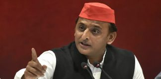 Samajwadi Party President Akhilesh Yadav addresses a press conference at party office in Lucknow