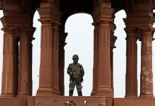 Security personnel stand guard over Raisina Hill in New Delhi| T. Narayan/Bloomberg