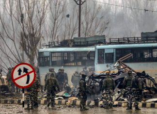 Security personnel at the site of suicide bomb attack, Pulwama | PTI