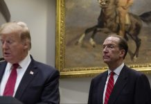 David Malpass, World Bank president nominee for U.S. President Donald Trump, right, listens while Trump speaks in the Roosevelt Room of the White House in Washington, D.C., on 6 Feb., 2019