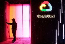 A worker stands by a Google Inc. 'Google Cloud' pop-up space in Davos, Switzerland| Jason Alden/Bloomberg