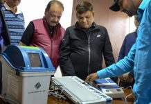An election official demonstrates the working of a Voter-Verified Paper Audit Trail   PTI