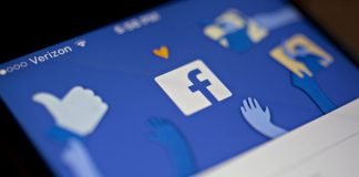 The Facebook Inc. application logo on display | Andrew Harrer/Bloomberg