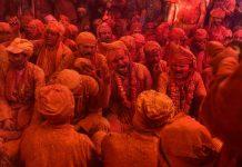 People play Holi in Barsana, Mathura
