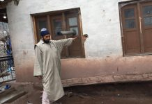 Farooq Ahmad, a Balkote resident points at cracks on his walls caused due to shelling | Moushumi Das Guota/ThePrint