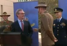Australian defence minister Christopher Pyne (L) and defence chief Angus Campbell at the press conference