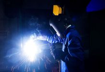 A student attends a welding class during vocational training at the Infrastructure Leasing & Financial Services (IL&FS) Institute of Skills in New Delhi, India
