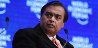 Mukesh Ambani, billionaire and chairman and managing director of Reliance Industries Ltd., pauses during a panel session at the World Economic Forum (WEF) in Davos, Switzerland