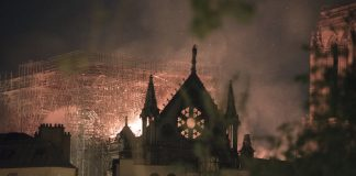 Flames and smoke rise from a fire at Notre-Dame Cathedral in Paris