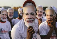 Supporters of PM Narendra Modi wear his masks, Mumbai | Dhiraj Singh | Bloomberg