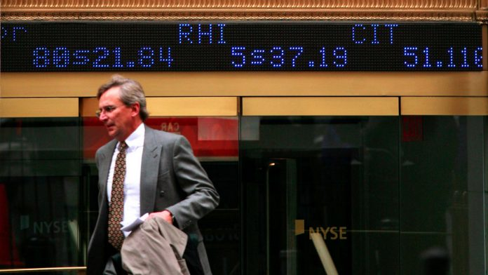 A man leaves the New York Stock Exchange in New York, Wednesday