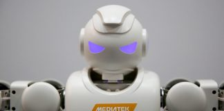 A robot stands on display on the MediaTek Inc. stand
