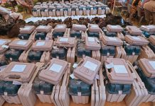 File Photo | Polling officials collect EVMs and other material from a distribution centre, Jaipur | PTI