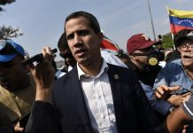 Juan Guaido leads a crowd protest pressing for military uprising against President Maduro